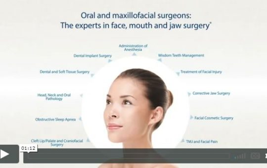 """Photograph of a woman with the headline, """" Oral and Maxillofacial surgeons: The experts in face, mouth and jaw surgery."""""""