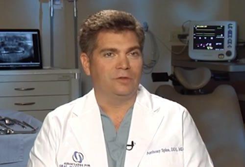 Oral surgeon discussing frenectomy procedure.