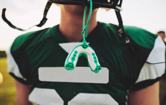 Football player with mouth guard.