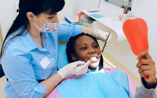 Young women visiting dentist.